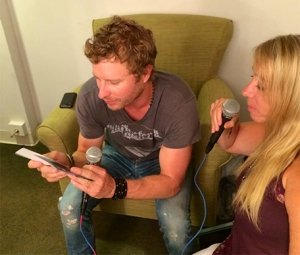 """Dierks checking out all of your """"Drunk on a..."""" photos! Thanks for sending those in!"""